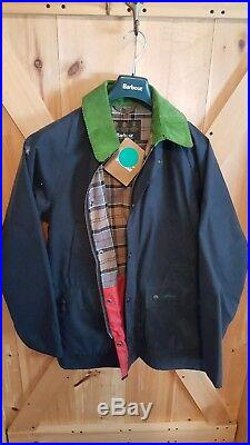 Barbour Owestry Mens Medium. Waxed navy with lime collar. RARE to find
